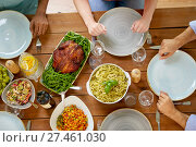 Купить «group of people with chicken and pasta on table», фото № 27461030, снято 5 октября 2017 г. (c) Syda Productions / Фотобанк Лори