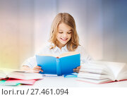 happy smiling student girl reading book. Стоковое фото, фотограф Syda Productions / Фотобанк Лори