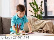 Купить «boy with notebook and pencils drawing at home», фото № 27461174, снято 4 ноября 2017 г. (c) Syda Productions / Фотобанк Лори