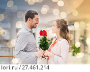 Купить «happy young couple with flowers in mall», фото № 27461214, снято 10 ноября 2014 г. (c) Syda Productions / Фотобанк Лори