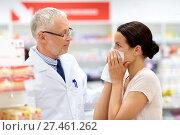 Купить «apothecary and sick customer at pharmacy», фото № 27461262, снято 27 июня 2015 г. (c) Syda Productions / Фотобанк Лори