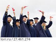 Купить «happy students in mortar boards with diplomas», фото № 27461274, снято 24 сентября 2016 г. (c) Syda Productions / Фотобанк Лори