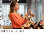 Купить «young woman choosing shoes at store», фото № 27461434, снято 22 сентября 2017 г. (c) Syda Productions / Фотобанк Лори