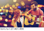 Купить «couple of musicians playing guitar over lights», фото № 27461490, снято 11 декабря 2014 г. (c) Syda Productions / Фотобанк Лори