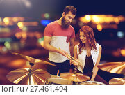 Купить «man and woman with drum kit at music store», фото № 27461494, снято 11 декабря 2014 г. (c) Syda Productions / Фотобанк Лори