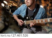 Купить «close up of musician playing guitar at studio», фото № 27461526, снято 18 августа 2016 г. (c) Syda Productions / Фотобанк Лори
