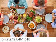 Купить «group of people at table praying before meal», фото № 27461610, снято 5 октября 2017 г. (c) Syda Productions / Фотобанк Лори