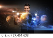 businessman with virtual planets and space. Стоковое фото, фотограф Syda Productions / Фотобанк Лори
