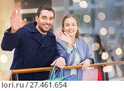 Купить «happy young couple with shopping bags in mall», фото № 27461654, снято 10 ноября 2014 г. (c) Syda Productions / Фотобанк Лори