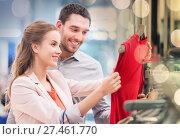 Купить «happy young couple choosing dress in mall», фото № 27461770, снято 10 ноября 2014 г. (c) Syda Productions / Фотобанк Лори