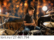 Купить «musician playing drum kit at concert over lights», фото № 27461794, снято 18 августа 2016 г. (c) Syda Productions / Фотобанк Лори