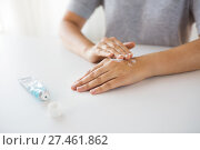 close up of hands with cream or therapeutic salve. Стоковое фото, фотограф Syda Productions / Фотобанк Лори