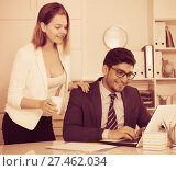 Купить «Business couple flirting in office», фото № 27462034, снято 1 июня 2017 г. (c) Яков Филимонов / Фотобанк Лори