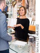 Купить «Cheerful female offering to buy necklace», фото № 27464602, снято 16 октября 2017 г. (c) Яков Филимонов / Фотобанк Лори