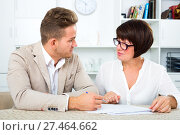 Man and mature woman sit at table. Стоковое фото, фотограф Яков Филимонов / Фотобанк Лори