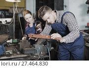 Купить «master working with level», фото № 27464830, снято 10 октября 2017 г. (c) Яков Филимонов / Фотобанк Лори