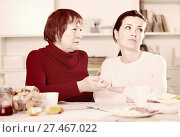 Купить «Portrait of sad mature woman talking with daughter», фото № 27467022, снято 23 ноября 2017 г. (c) Яков Филимонов / Фотобанк Лори