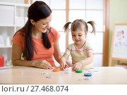 Купить «Mom with creative child having fun time together», фото № 27468074, снято 1 ноября 2017 г. (c) Оксана Кузьмина / Фотобанк Лори