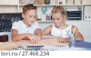 Купить «Boy with sister are playing in game at home.», видеоролик № 27468234, снято 11 августа 2017 г. (c) Яков Филимонов / Фотобанк Лори