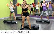 Portrait of sporty women exercising with barbell in fitness club. Стоковое видео, видеограф Яков Филимонов / Фотобанк Лори