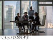 Business people working in an office on a background of panoramic windows. Стоковое фото, фотограф Женя Канашкин / Фотобанк Лори