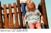 Купить «Schoolboy enjoying while playing on slide», видеоролик № 27520470, снято 26 июня 2019 г. (c) Wavebreak Media / Фотобанк Лори