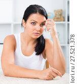 Купить «Sad brunette wipes tears», фото № 27521378, снято 18 февраля 2018 г. (c) Яков Филимонов / Фотобанк Лори