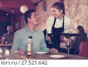 Купить «Smiling waitress bringing delicious meal to young man», фото № 27521642, снято 18 декабря 2017 г. (c) Яков Филимонов / Фотобанк Лори