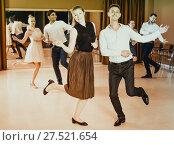 Купить «People practicing twist movements», фото № 27521654, снято 24 мая 2017 г. (c) Яков Филимонов / Фотобанк Лори