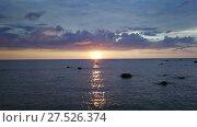 Купить «Aerial landscape with tropical sunset and stones», видеоролик № 27526374, снято 25 января 2018 г. (c) Михаил Коханчиков / Фотобанк Лори