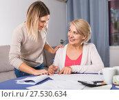Купить «Daughter helps mother to lead home accounting», фото № 27530634, снято 13 ноября 2017 г. (c) Яков Филимонов / Фотобанк Лори