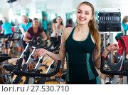 Купить «Females cycling in sport club», фото № 27530710, снято 20 июля 2018 г. (c) Яков Филимонов / Фотобанк Лори