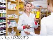 Купить «Mature female seller suggesting care products to young customer», фото № 27530910, снято 15 марта 2017 г. (c) Яков Филимонов / Фотобанк Лори