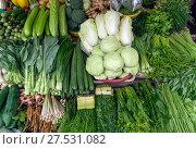 Купить «Vegetables, spices, roots and herbs on market», фото № 27531082, снято 10 января 2017 г. (c) Михаил Коханчиков / Фотобанк Лори