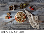National Cretan, Greek snack (dakos). Crackers with grated tomatoes, feta cheese, oregano, olives and olive oil on a wooden table close-up. Стоковое фото, фотограф Татьяна Ляпи / Фотобанк Лори