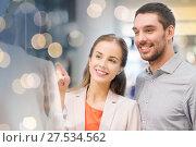 Купить «happy couple pointing finger to shop window», фото № 27534562, снято 10 ноября 2014 г. (c) Syda Productions / Фотобанк Лори