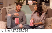 Купить «happy couple eating pop corn at home», видеоролик № 27535786, снято 23 января 2018 г. (c) Syda Productions / Фотобанк Лори