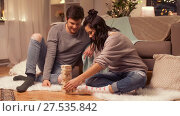 happy couple playing block-stacking game at home. Стоковое видео, видеограф Syda Productions / Фотобанк Лори