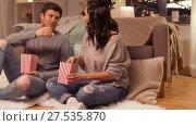 Купить «happy couple eating pop corn at home», видеоролик № 27535870, снято 23 января 2018 г. (c) Syda Productions / Фотобанк Лори