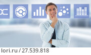 Businessman smiling and business chart statistic icons. Стоковое фото, агентство Wavebreak Media / Фотобанк Лори