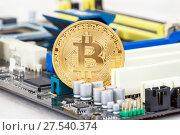 Купить «Cryptocurrency golden Bitcoin lying over electronic computer component. Business concept of digital money», фото № 27540374, снято 11 декабря 2017 г. (c) FotograFF / Фотобанк Лори
