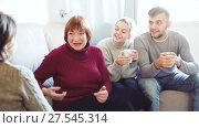 Купить «Portrait of happy family enjoying conversation over cup of coffee at home», видеоролик № 27545314, снято 20 декабря 2017 г. (c) Яков Филимонов / Фотобанк Лори