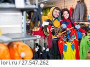 Купить «Couple showing shoes clothes and things for a hike», фото № 27547262, снято 8 марта 2017 г. (c) Яков Филимонов / Фотобанк Лори