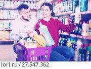 Купить «Couple choose some detergents», фото № 27547362, снято 14 марта 2017 г. (c) Яков Филимонов / Фотобанк Лори