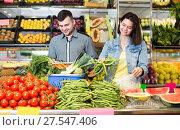 Купить «Cheerful couple examining various vegetables», фото № 27547406, снято 18 марта 2017 г. (c) Яков Филимонов / Фотобанк Лори