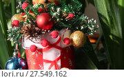 Купить «Рождественская игрушка. Медведь сидит в валенке среди елочных игрушек», видеоролик № 27549162, снято 20 ноября 2017 г. (c) Олег Хархан / Фотобанк Лори