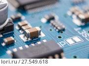 Купить «Close-up of electronic circuit board», фото № 27549618, снято 2 февраля 2018 г. (c) Александр Якимов / Фотобанк Лори