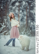 Купить «Beautiful woman with dog samoyed in winter forest», фото № 27550150, снято 2 февраля 2018 г. (c) Julia Shepeleva / Фотобанк Лори