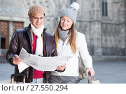 Купить «Cheerful man and woman with map», фото № 27550294, снято 18 ноября 2017 г. (c) Яков Филимонов / Фотобанк Лори