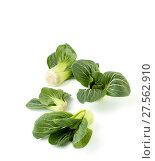 Купить «Beans Chinese cabbage Pak-choi (salad) on a clean white background. Isolated.», фото № 27562910, снято 4 февраля 2018 г. (c) Olesya Tseytlin / Фотобанк Лори